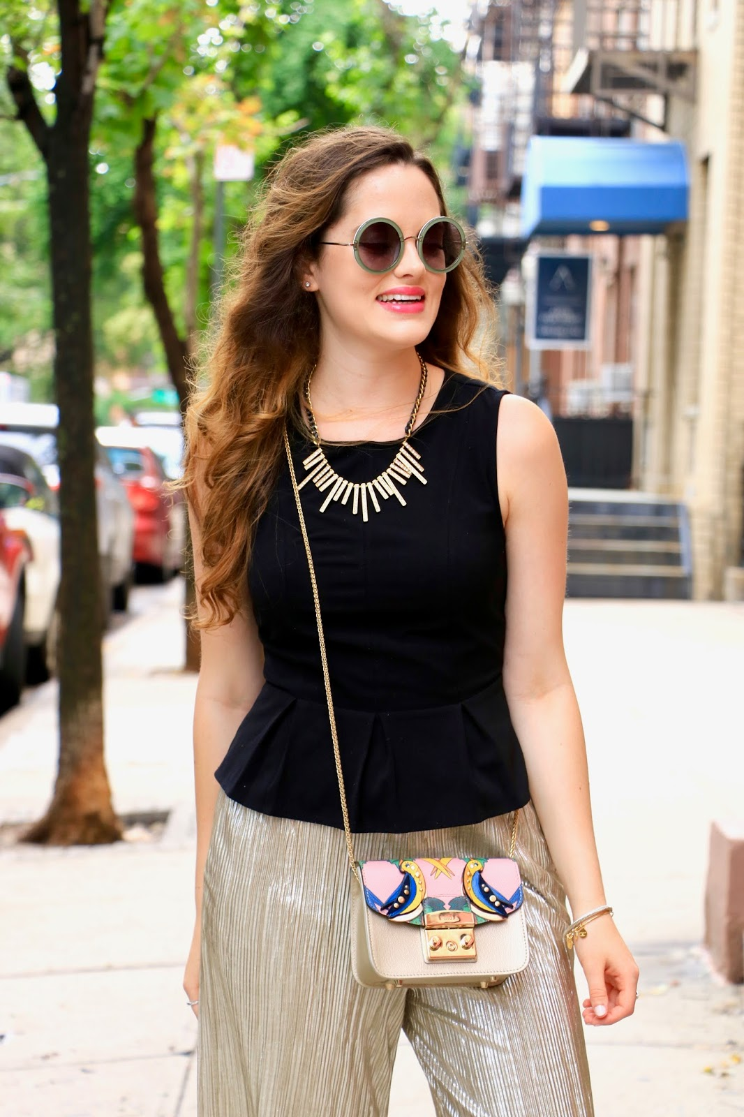 nyc fashion blogger Kathleen Harper carrying a parrot Furla bag
