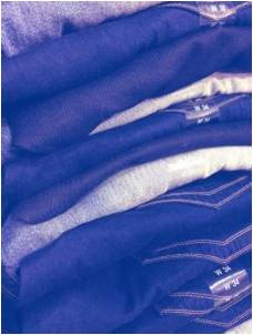Pants stacked on one another. Folding your clothes properly is important when trying to pack clothes for moving.