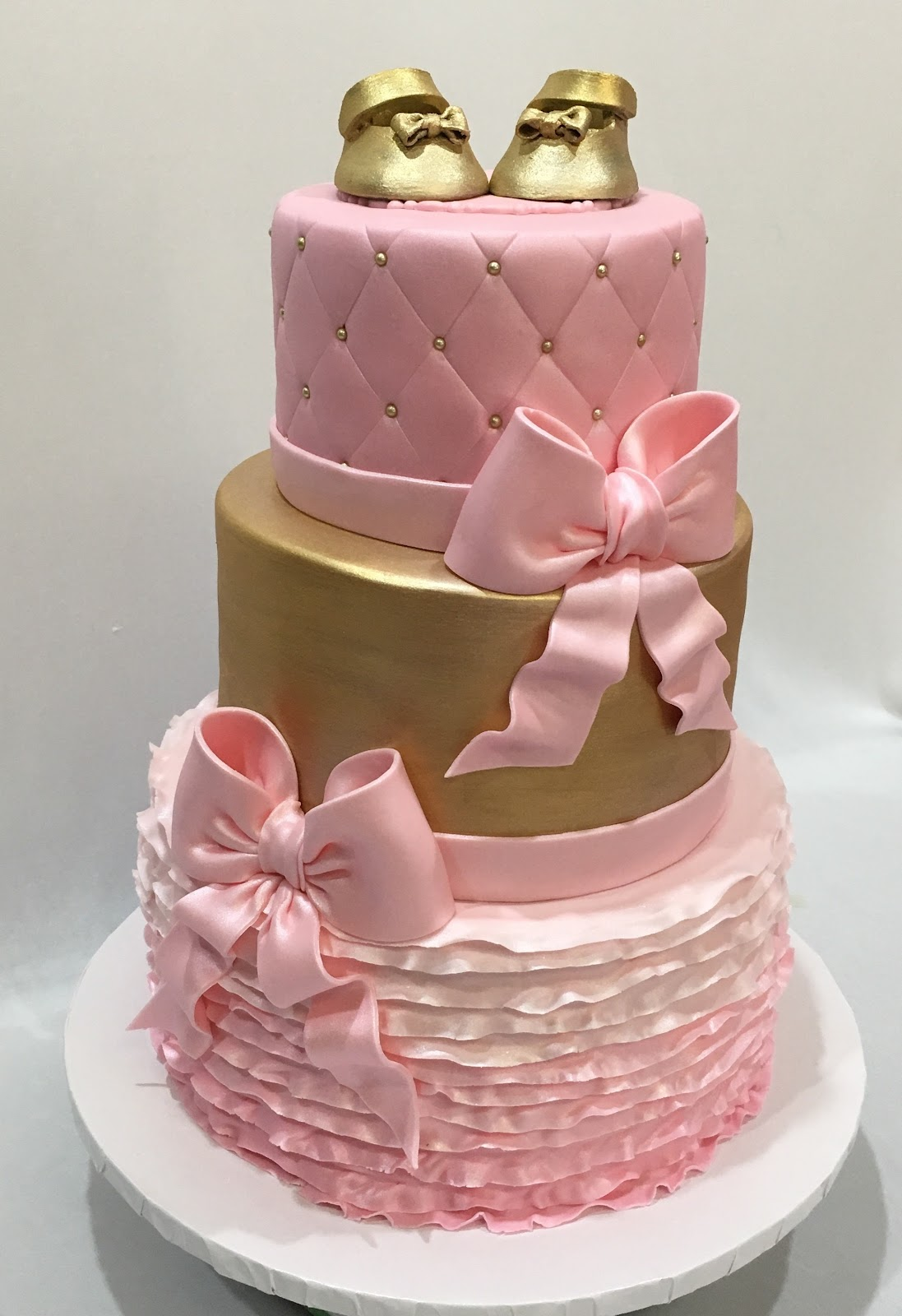 MyMoniCakes: Pink and gold baby shower cakes with ruffled tiers and ...