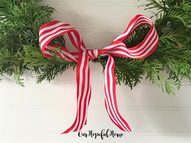 red and white candy stripe Christmas bow