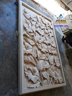 Relief batu alam paras jogja / batu putih untuk hiasan tempel pada dinding rumah gambar motif bunga sepatu