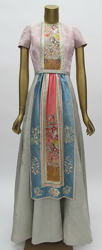 Long multi-colored dress with Asian look by Mainbocher displayed on dress form