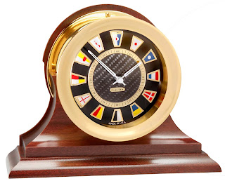 https://bellclocks.com/collections/chelsea-clock/products/chelsea-carbon-fiber-flag-clock-on-mahogany-base-brass