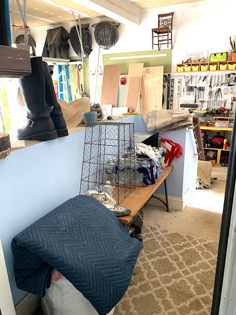a corner of the garage is transformed into a mudroom