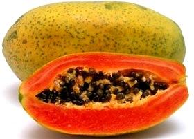 Foto de una papaya entera y partida - Fruta