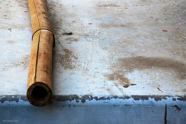 A Minimalist Photograph of a Bamboo Stick on a Metal Cooler.