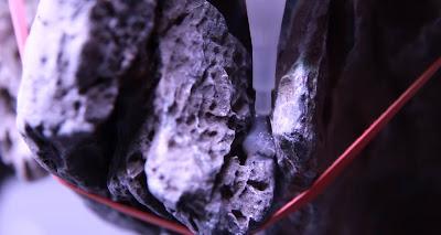 attaching hardscape rocks with super glue and cigarette filter