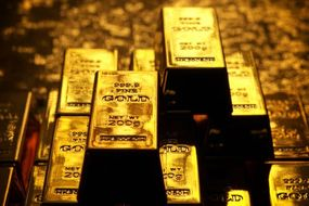 Gold surges toward biggest monthly gain in three years as US and China brace for G20 meet