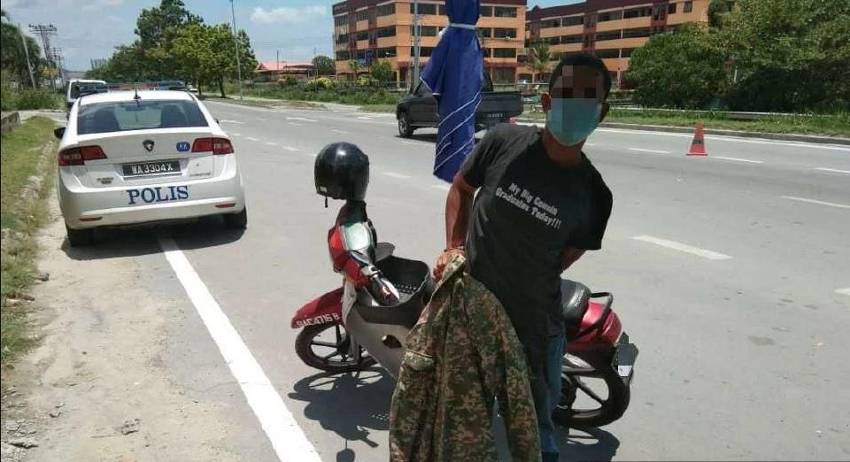 Pakai Baju Celoreng Askar Untuk Lepasi Sekatan Jalan Raya PKP