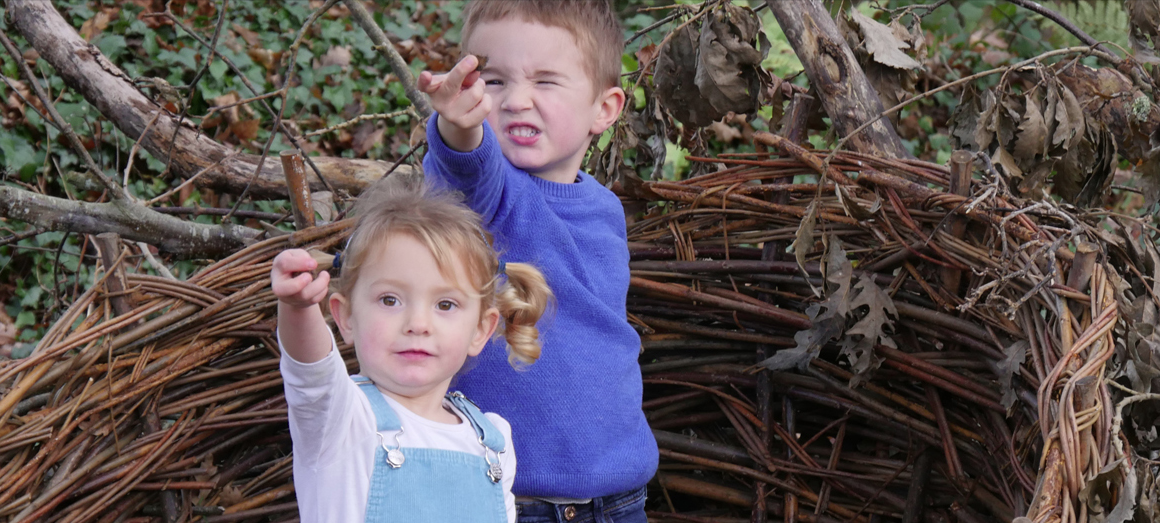 Two kids playing at Pinetum Gardens in Cornwall