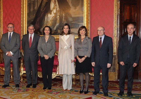 Queen Letizia carried Carolina Herrera Authenticity Card Camelot Collection Handbag and she wore Carolina Herrera wool and cashmere coat