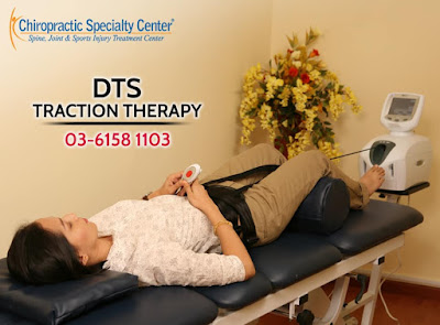 Female Getting DTS Therapy for back pain