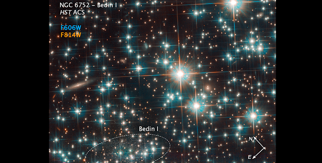 This is a Hubble Space Telescope image of a concentration of stars within the globular cluster NGC 6752. Hidden among the stars is an image of a background galaxy that is much farther away. The diminutive galaxy, named by its discoverers as Bedin 1, measures only around 3,000 light-years at its greatest extent — a fraction of the size of the Milky Way. Not only is it tiny, but it is also incredibly faint. These properties led astronomers to classify it as a dwarf spheroidal galaxy that is as old as the universe. Credit: NASA, ESA, and L. Bedin (Astronomical Observatory of Padua, Italy)