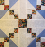 Quilt pattern block tutorial made of triangles and squares by The Quilt Ladies