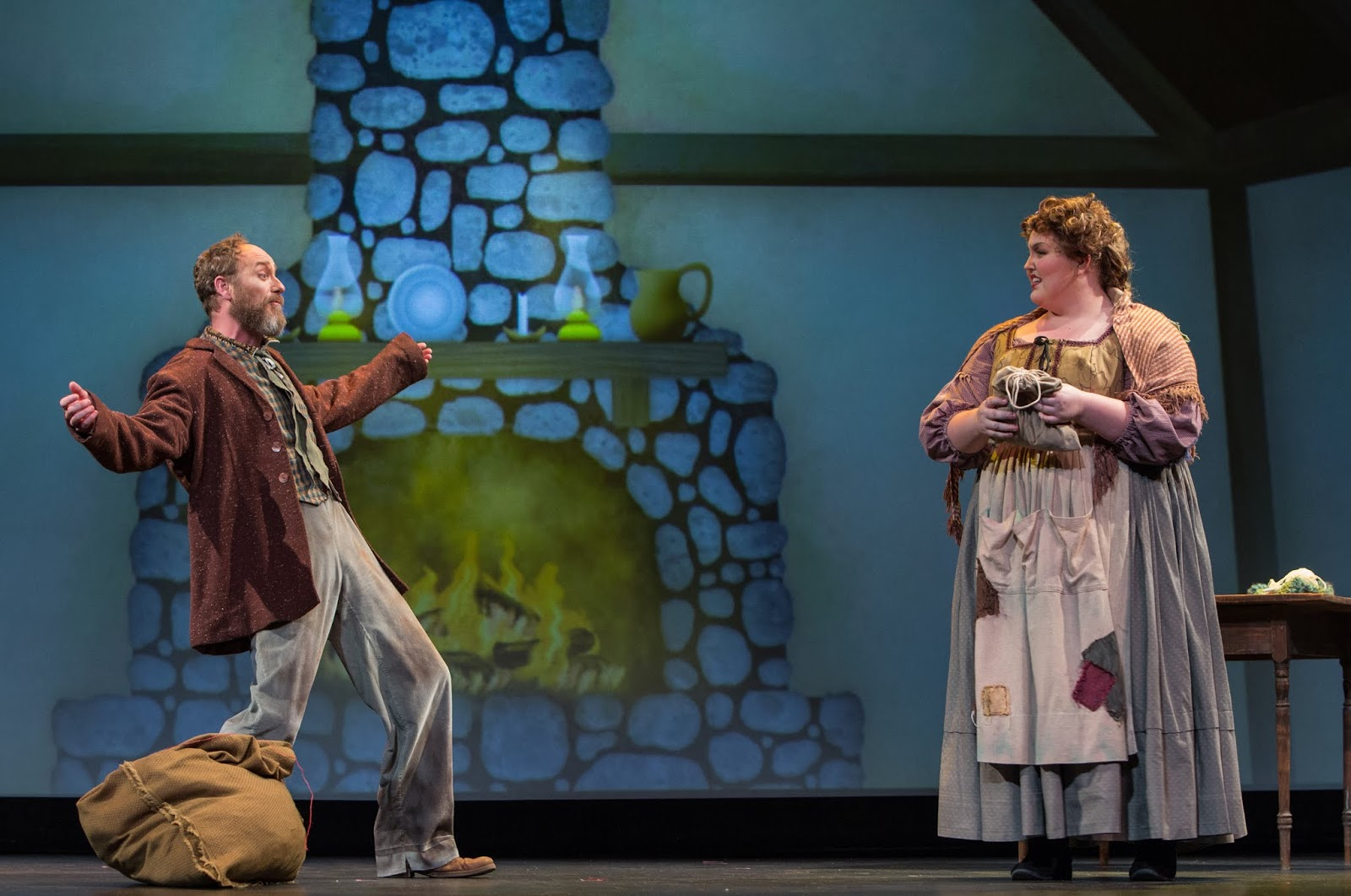 IN PERFORMANCE: baritone SCOTT MACLEOD as Peter (left) and soprano LYNDSEY SWANN as Gertrud (right) in Greensboro Opera's March 2019 production of Engelbert Humperdinck's HÄNSEL UND GRETEL [Photograph © by VanderVeen Photographers]