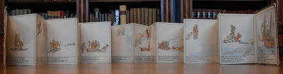 "A fold-out set of illustrated pages from ""The Children of the North Pole."""