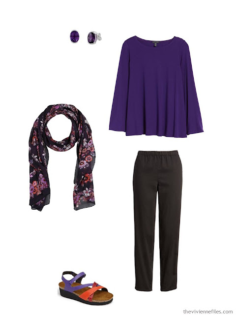 wearing an ultraviolet tunic with black cotton pants
