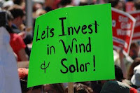 """Let's Invest in Wind & Solar"" sign (Credit: renewableenergyworld.com) Click to Enlarge."