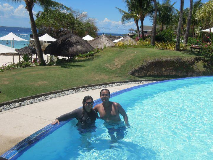 Travel couple blogger swimming at Shangri-La's Mactan Resort and Spa