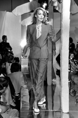Jerry Hall modeling 1990 power suit