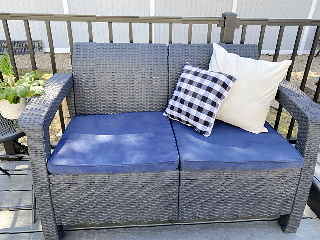 love seat with painted blue cushions and pillows