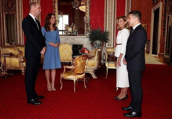 Kate Middleton wore a blue v-neck belted bespoke dress from Emilia Wickstead, and her praline Gianvito Rossi pumps. First Lady Olena Zelenska