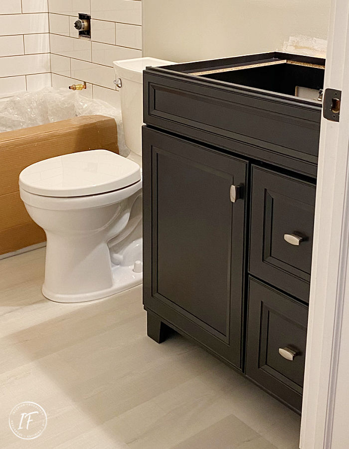How we saved thousands of dollars on a small bathroom renovation by doing it ourselves. Before and After reveal plus full bathroom remodel checklist.