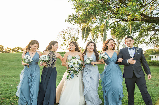 bride and bridesmaids in blue walking
