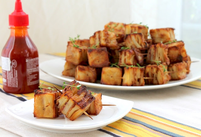 Food Lust People Love:Parmesan Bacon Potato Squares are a tasty appetizer (or side dish) of thinly sliced potatoes layered with bacon, cream and cheese that turn crispy and more-ish when they are baked, cooled then cut into squares and roasted in the oven.