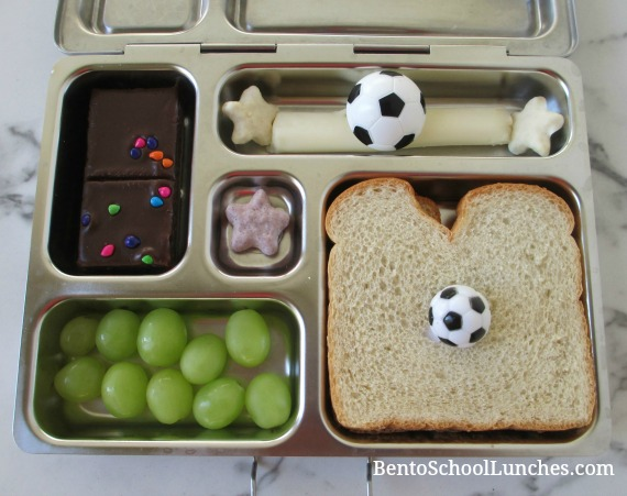 Soccer pick on a simple sandwich and a soccer ring on string cheese