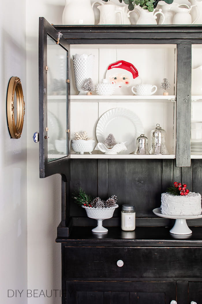 black hutch with Christmas dishes
