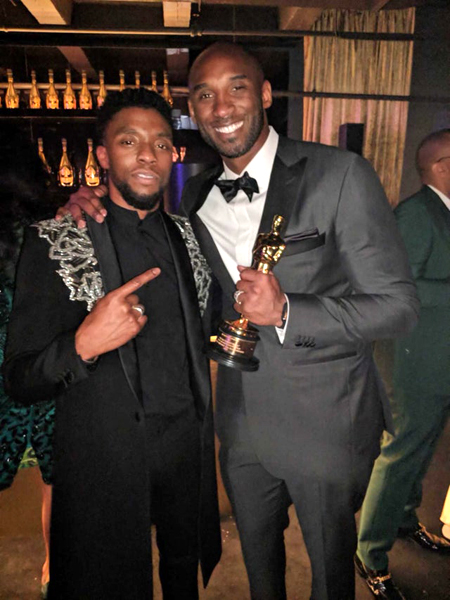 Chadwick Boseman and Kobe Bryant pose for a photo at the 2018 Academy Awards...on March 4, 2018.