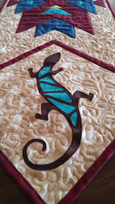 http://www.craftsy.com/pattern/quilting/home-decor/lizard-applique-template/175009