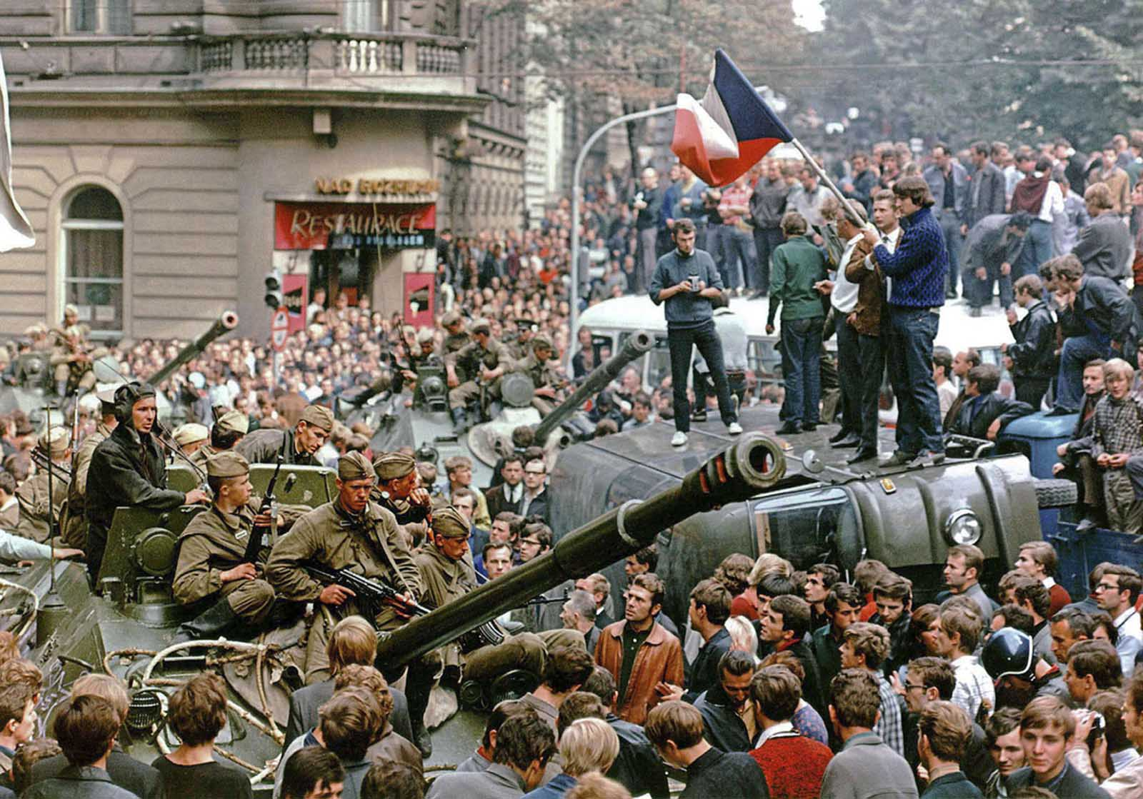 Prague residents surround Soviet tanks in front of the Czechoslovak Radio building, in central Prague, during the first day of the Soviet-led invasion of Czechoslovakia, on August 21, 1968.