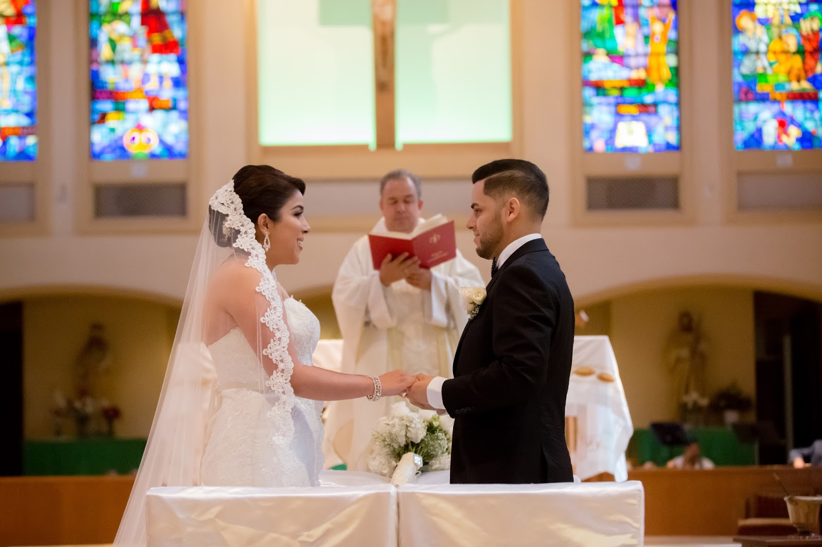Bride and Groom join hands at the Altar