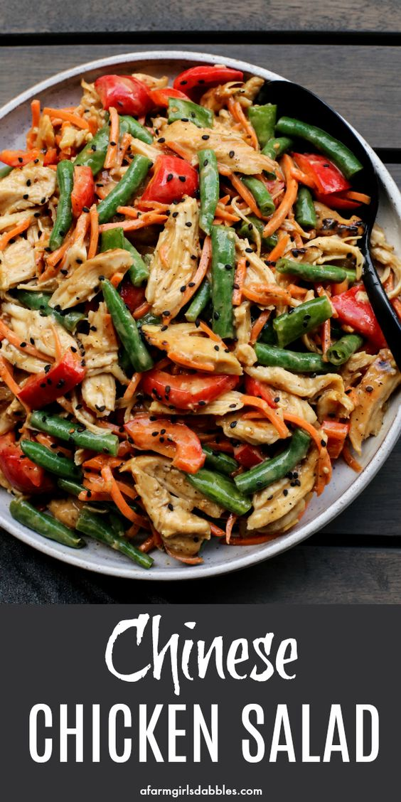 A flavorful Chinese chicken salad dressing is folded into shredded chicken and a colorful mix of fresh vegetables. This is one of our favorite recipes to enjoy an Asian salad! #chicken #chinese #asian #salad #peanutbutter #soysauce