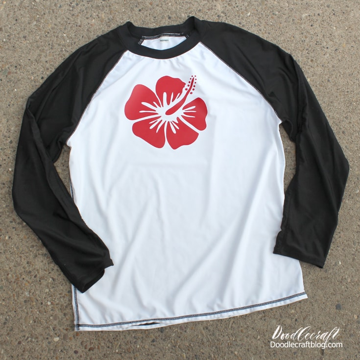Swimming shirts are perfect for summer, customize them with a tropical flower in red cut with cricut maker.