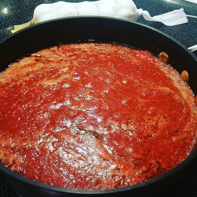 this is a homemade thick tomato Italian sauce with sausage and meatballs with pork spare ribs