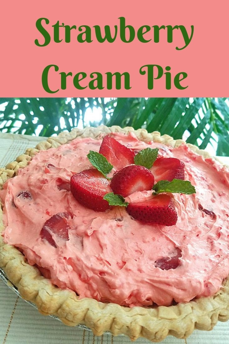 this is a strawberry cream  pie filled with strawberries, whipped cream and a jello pudding filling. Topped with a flower arrangement pattern using strawberries and mint leaves on top