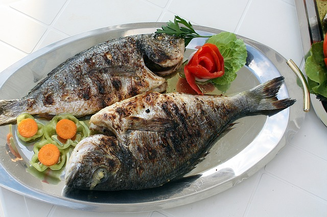 Two Whole Fish Baked with Vegetable Garnishes