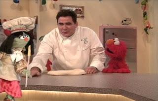 Jean the Genie summons Emeril Lagasse for to make pizza. Elmo is happy. Sesame Street Elmo's Magic Cookbook