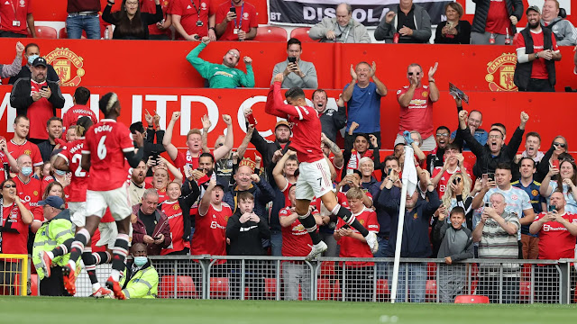 Manchester United forward Cristiano Ronaldo with his trademark celebration after scoring at Old trafford