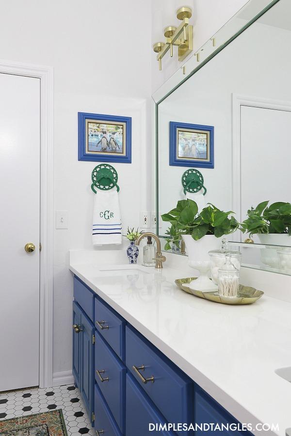 gold vanity lights, brass hardware, hom kitchen and bath, true white quartz counters, behr paint