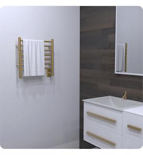 Small towel warming rack mounted to a bathroom wall.
