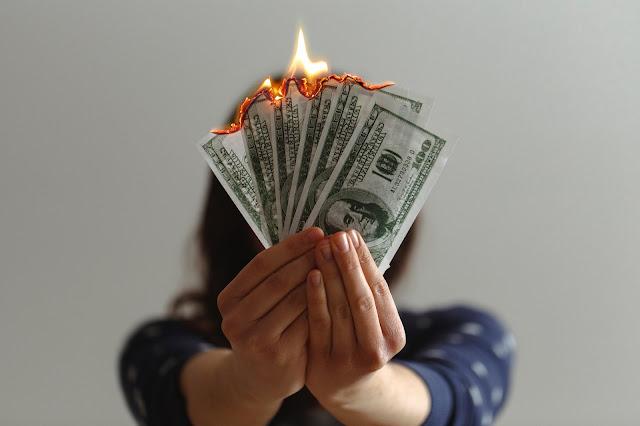 U.S dollar bills on fire