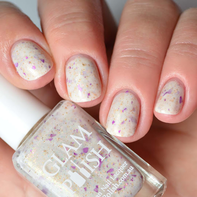 cream nail polish with flakies four finger swatch