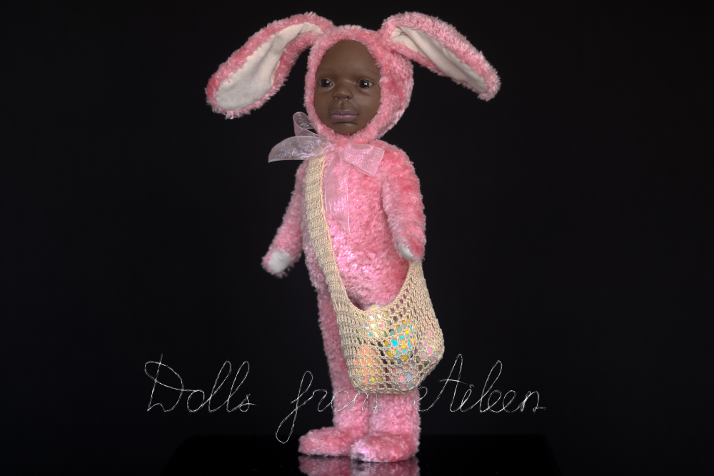 ooak Easter Bunny teddy doll with a bag full of Easter eggs, view from side