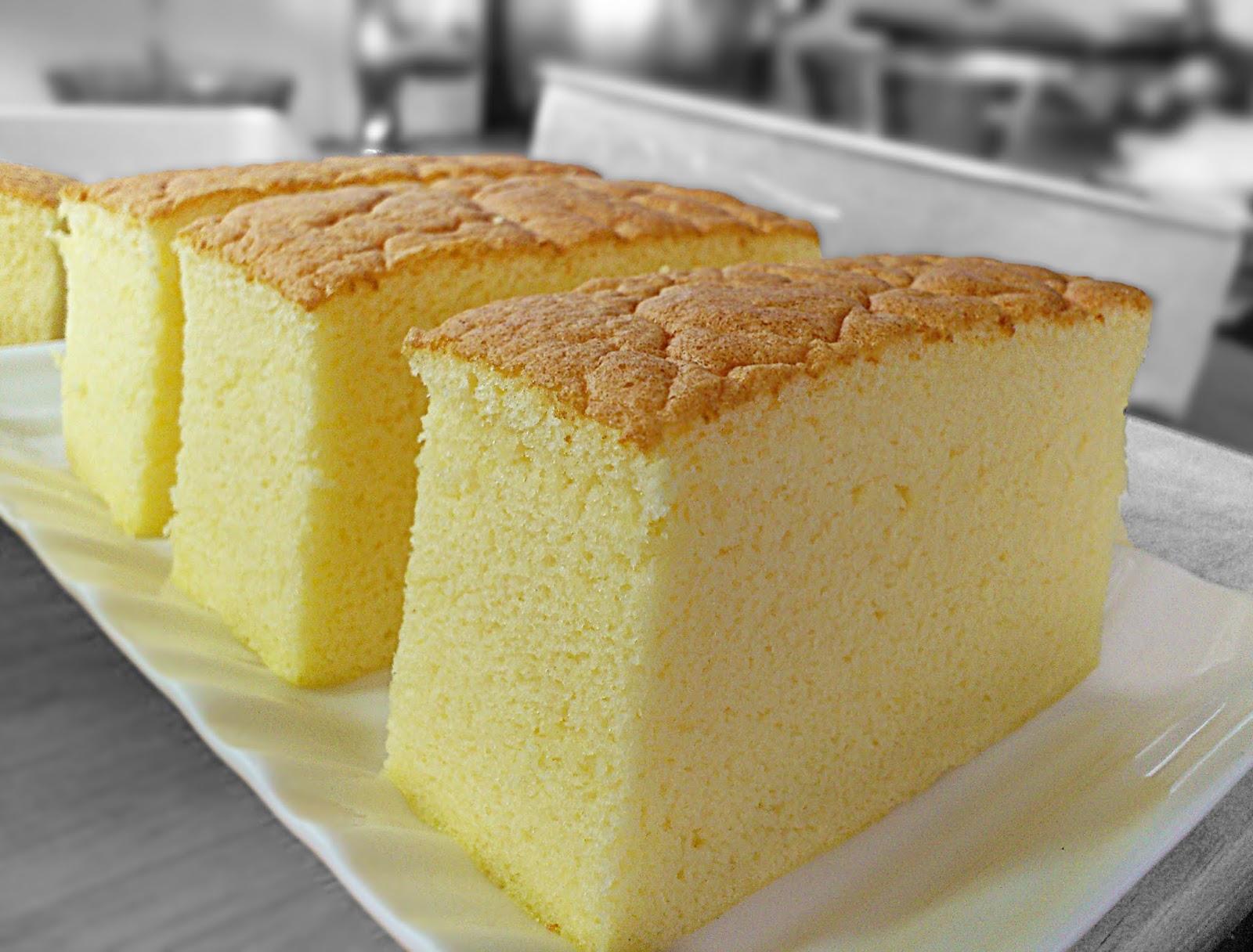 square ogura cake sitting on a cooling rack