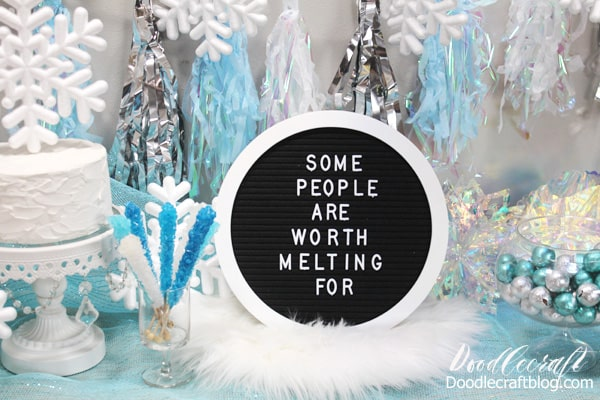 Winter wonderland or ice princess party with blue and silver decorations for the perfect Frozen themed party and holiday decor.
