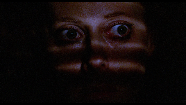 woman scared with her eyes wide open.